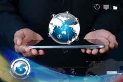 Businessman showing tablet with global networking Stock Image