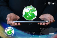 Businessman showing tablet with global networking Stock Images