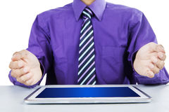 Businessman showing a tablet pc Royalty Free Stock Photography