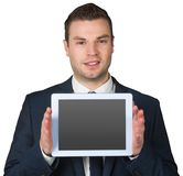 Businessman showing tablet pc screen Stock Images