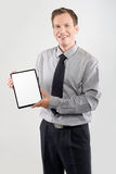 Businessman showing a tablet Royalty Free Stock Images