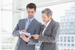 Businessman showing tablet to his colleague. In the office Royalty Free Stock Image