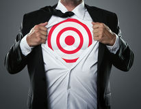 Businessman showing target symbol Royalty Free Stock Photos