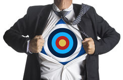Businessman showing a target under his shirt Royalty Free Stock Images