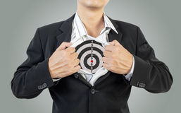 Businessman showing target under shirt Stock Images