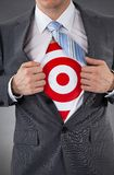 Businessman showing a target under shirt Royalty Free Stock Images