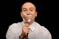 Businessman showing teeth Stock Photography