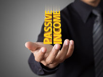 Businessman showing text passive income. Concept Royalty Free Stock Photos