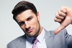 Businessman showing thumb down sign Royalty Free Stock Images