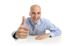 Businessman showing thumb up gesture Stock Image
