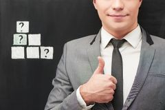 Businessman showing thumb up near chalked cubes Royalty Free Stock Photography