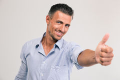 Businessman showing thumb up Stock Photos