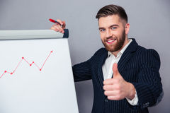 Businessman showing thumb up Royalty Free Stock Images