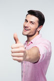 Businessman showing thumb up sign Stock Images