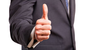 Businessman showing thumb up sign Stock Image
