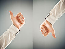 Businessman showing thumb up and thumb down symbol. Businessman showing thumb down and thumb up symbol. Approval and disapproval concept Royalty Free Stock Photos