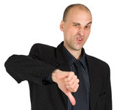 Businessman showing thumbs down Royalty Free Stock Images