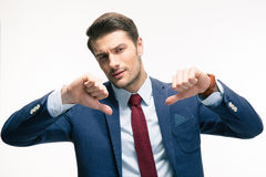 Businessman showing thumbs down sign Stock Images
