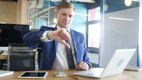 Businessman showing thumbs down stock video