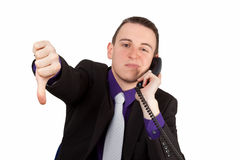 Businessman showing thumbs down Royalty Free Stock Photos