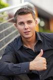 Businessman showing thumbs-up Stock Image