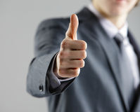 Businessman showing thumbs up. Royalty Free Stock Photo