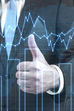 Businessman showing thumbs up. And business chart Royalty Free Stock Images