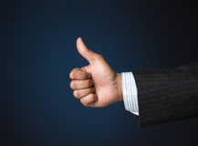Businessman showing thumbs up. Business person showing thumbs up for success and victory Royalty Free Stock Photography