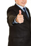 Businessman showing thumbs up gesture. Close-up. Stock Photography