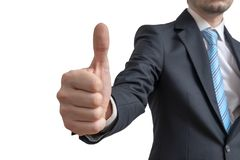 Businessman is showing thumbs up gesture. Isolated on white background royalty free stock images