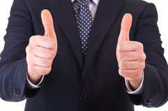 Business man showing thumbs up sign. Stock Images