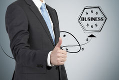 Businessman showing thumbs. Up sign and drawing icons  isolation on gray Royalty Free Stock Image