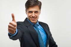 Businessman showing  thumbs up sign on white background Royalty Free Stock Photography