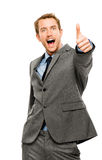 Businessman showing thumbs up sign white background Stock Images
