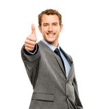 Businessman showing thumbs up sign white background Royalty Free Stock Photos