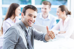 Businessman showing thumbs up Stock Images