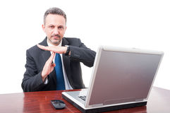 Businessman showing time out sign Royalty Free Stock Images