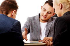 Businessman showing to people something on tablet Stock Images