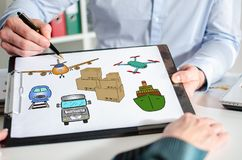 Transportation concept on a clipboard. Businessman showing transportation concept on a clipboard Royalty Free Stock Images