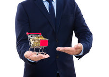 Businessman showing trolley with gold coin Royalty Free Stock Image