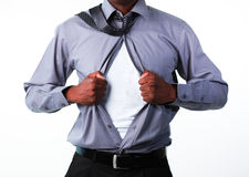 Businessman showing tshirt under his suit Stock Photography