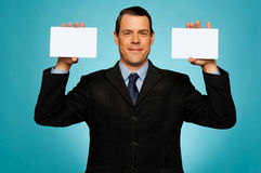 Businessman showing two blank white placards Stock Photo