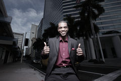 Businessman showing two thumbs up Stock Photo