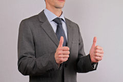 Businessman showing two thumbs up sign close up. Teamwork,  success concept Stock Photo