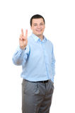 Businessman showing Victory sign. Isolated on white background Stock Photography