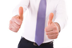 Business man showing Victory sign. Royalty Free Stock Photo