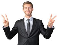 Businessman showing victory sign. Young businessman showing victory sign Stock Photo