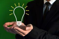 Businessman showing a virtual bulb symbol stock photo