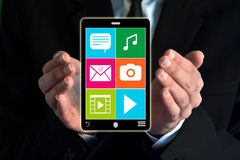 Businessman showing a virtual smartphone Royalty Free Stock Photo