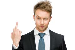 Businessman showing vulgar gesture. Portrait of businessman showing obscene gesture, isolated on white. Concept of stress and aggression Royalty Free Stock Image